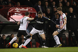 February 13, 2019 - Sheffield, South Yorkshire, United Kingdom - SHEFFIELD, UK 13TH FEBRUARY Jonathan Howson of Middlesbrough and Sheffield United's John Fleck (L) and Kieran Dowell  during the Sky Bet Championship match between Sheffield United and Middlesbrough at Bramall Lane, Sheffield on Wednesday 13th February 2019. (Credit: Mark Fletcher | MI News) (Credit Image: © Mi News/NurPhoto via ZUMA Press)