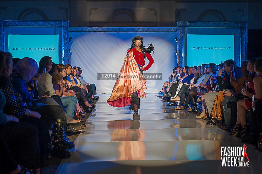 FASHION WEEK NEW ORLEANS: Designer Jose Luis Rodriguez show case his fashion design on the runway at the Board of Trade, Fashion Week New Orleans on Wednesday March 19. 2014. #FWNOLA, #FashionWeekNOLA, #Design #FashionWeekNewOrleans, #NOLA, #Fashion #BoardofTrade, #GustavoEscanelle, #TraceeDundas #DominiqueWhite<br /> View more photos at http://Gustavo.photoshelter.com.