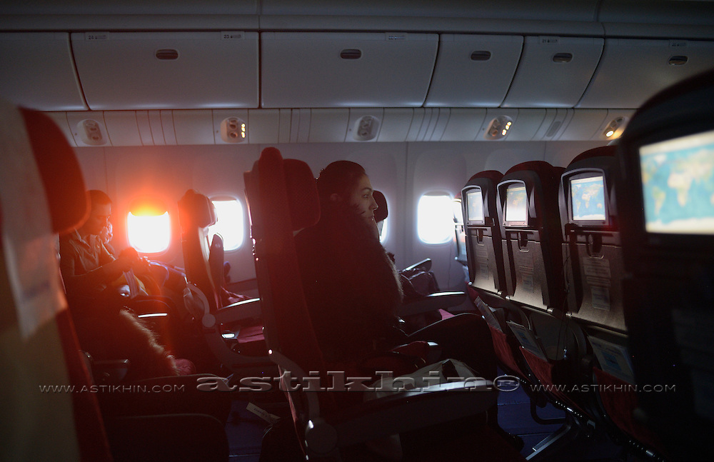Air passengers flying on an airplane at morning.