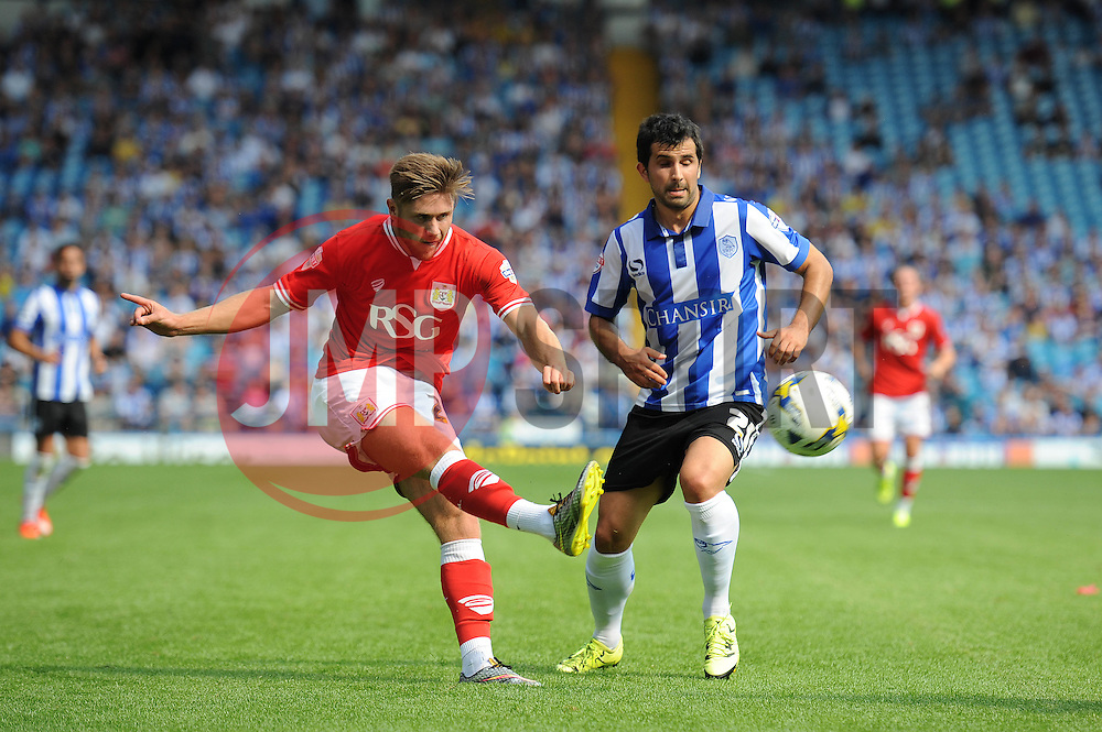 Wes Burns of Bristol City crosses the ball under pressure from Alex Lopez of Sheffield Wednesday - Mandatory byline: Dougie Allward/JMP - 07966386802 - 08/08/2015 - FOOTBALL - Hillsborough Stadium -Sheffield,England - Sheffield Wednesday v Bristol City - Sky Bet Championship