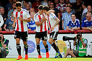 Brentford defender John Egan (14)  celebrating scoring with Brentford defender Harlee Dean (6)  1-0 during the EFL Sky Bet Championship match between Brentford and Ipswich Town at Griffin Park, London, England on 13 August 2016. Photo by Matthew Redman.