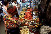 A vendor makes change on market day in Antigua. Guatemala. (Environs image from the project Hungry Planet: What the World Eats.)