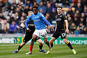 Jamal Lowe of Portsmouth under pressure during the EFL Sky Bet League 1 match between Portsmouth and Bradford City at Fratton Park, Portsmouth, England on 2 March 2019.