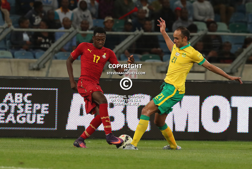 Baba Rahman of Ghana and Eleazar Rodgers of South Africa both go for the ball during the international friendly match between South Africa ( Bafana Bafana ) and Ghana at the Moses Mabhida stadium in Durban, South Africa on the 11th October 2016<br /> <br /> Photo by:   Steve Haag / Real Time Images