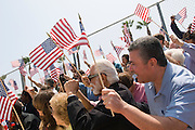 Crowd holding American flags