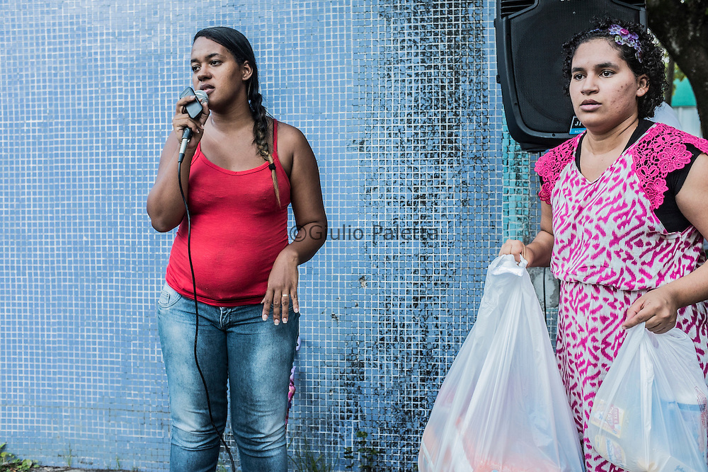 At the weekly meetings of the U.M.A. (União das Mães de Anjos) in Boa Viagem, Recife, Pernambuco. Created by mothers with infants with microcephaly in order to help other mothers in the same situation, this association is run by Germana Soares Amorem (24), left, and Jaqueline Vieira De Souza (25), center, here distributing donations at the other mothers
