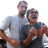 Rafael Muniz of Virginia, right, cries out as a family member comforts him Friday after a hearing for Dennis Elvin Cervantes Pavon, accused of fatally stabbing Muniz's son, Raymond Muniz, on Wednesday in Mount Pleasant. (ANDREW KNAPP/STAFF)