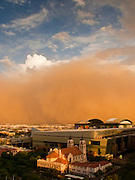 "18 JULY 2009 -- PHOENIX, AZ: A ""haboob"" blows into downtown Phoenix Saturday night. A haboob is a type of intense sandstorm commonly observed in the Sahara desert (typically Sudan), as well as across the Arabian Peninsula, throughout Kuwait, and in the most arid regions of Iraq. The word haboob comes from the Arabic word for ""Strong Wind.""  PHOTO BY JACK KURTZ"