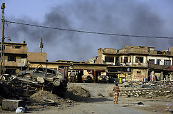July 3, 2017 - Mosul, Iraq - Smoke rises over West Mosul as air strikes and suicide bombings occur. Civilians, many injured and weak, flee the continued battle with ISIS in West Mosul on July 3, 2017.  They are brought to a trauma stabilization site near the Old City. (Credit Image: © Carol Guzy via ZUMA Wire)