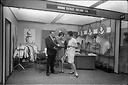18/04/1966<br /> 04/18/1966<br /> 18 April 1966<br /> Stands and Models at the 3rd Irish Export Fashion Fair at the Intercontinental Hotel, Dublin. Mr. D.D. O'Kelly, Marina Textiles (Ireland) Ltd.; Miss M. Ledwith and Miss L Nelson, photographed at the Marina Textiles stand.