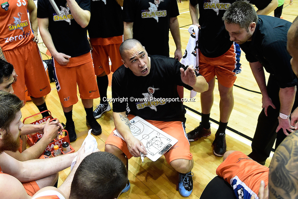 Head coach of the Sharks Paul Henare speaks to his team during a NBL - Hawks vs Sharks semi final four basketball match at the TSB Arena in Wellington on Friday the 4th of July 2014. Photo by Marty Melville/www.Photosport.co.nz