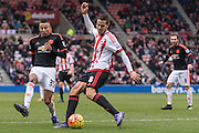 Sunderland's Midfielder Jack Rodwell  clears the ball from danger, followed by Manchester United's Midfielder Jesse Lingard during the Barclays Premier League match between Sunderland and Manchester United at the Stadium Of Light, Sunderland, England on 13 February 2016. Photo by George Ledger.