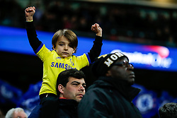 A young Chelsea fan celebrates after his team win the Capital One Cup Final - Photo mandatory by-line: Rogan Thomson/JMP - 07966 386802 - 01/03/2015 - SPORT - FOOTBALL - London, England - Wembley Stadium - Chelsea v Tottenham Hotspur - Capital One Cup Final.
