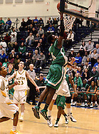 CJ sophomore Justin Bibbs (11) at the basket for two points in the third quarter as the Chaminade Julienne Eagles play the Alter High School Knights at Trent Arena in Kettering, Friday, January 20, 2012.