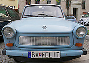 Vienna, Austria. A Trabant owner from Bratislava, Slovakia jokes about the materials used to build his car on his license plate.