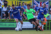 Leeds United's Stuart Dallas(15) and Forest Green Rovers Theo Archibald(18) during the Pre-Season Friendly match between Forest Green Rovers and Leeds United at the New Lawn, Forest Green, United Kingdom on 17 July 2018. Picture by Shane Healey.