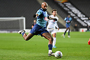 Wycombe Wanderers forward Josh Parker (27) takes a shot at goal during the EFL Trophy match between Milton Keynes Dons and Wycombe Wanderers at stadium:mk, Milton Keynes, England on 12 November 2019.