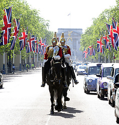©  licensed to London News Pictures. . UK.27/04/2011.Royal Wedding Preparations today in London with only two days to go before the big day..Captain Edward Olver (front rider) making up The Queens Life Guard before the Royal Wedding today on The Mall..Please see special instructions..Picture credit should read Grant Falvey/LNP......