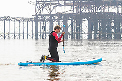 © Licensed to London News Pictures.12/04/2020. Brighton, UK. A man can be seen taking exercise by using his paddle board in Brighton and Hove as the Coronavirus Lockdown continues. Only a handful of people can be seen outside in the seaside resort on Easter Sunday. Photo credit: Hugo Michiels/LNP