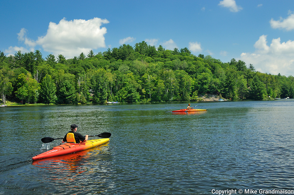 Two kayakers kayaking on Raven Lake<br />