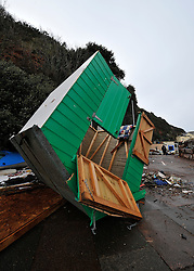 © Licensed to London News Pictures. Date 07/02/2014. Dawlish, UK. Damaged beach huts. Storm damage to railway and to sea front from the previous storm is hurried shored up by Network rail to prevent the houses from collapsing into the sea ahead of the storm which will hit tomorrow morning. Photo credit : Mark Hemsworth/LNP