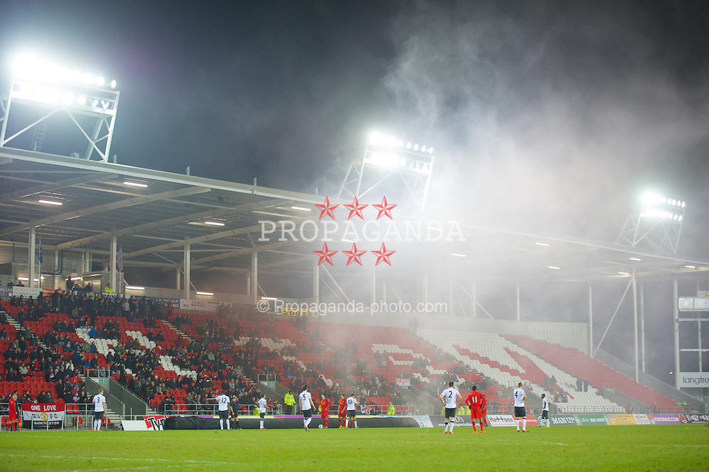 ST HELENS, ENGLAND - Monday, February 25, 2013: A smoke bomb thrown onto the pitch by a Manchester United supporter during the Premier League Academy match at Langtree Park. (Pic by David Rawcliffe/Propaganda)