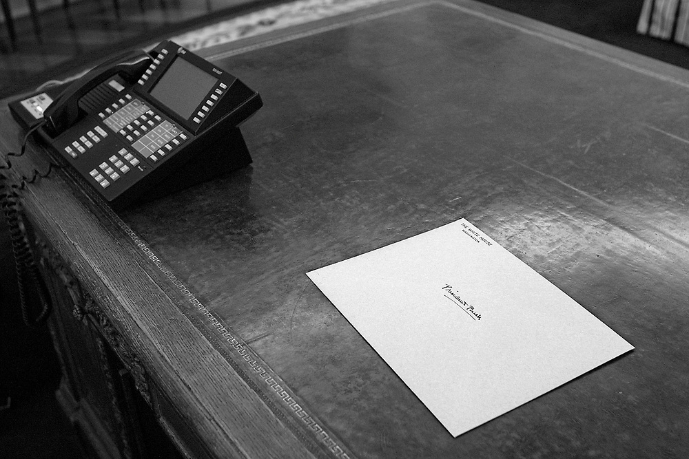 The envelope left by President Clinton with a note inside to incoming President Bush on the desk in the Oval Office.
