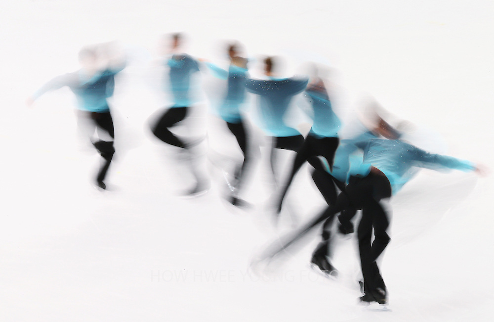A multiple exposure image shows Peter Liebers of Germany performing during the Men's Short Program of the Figure Skating event at the Iceberg Palace during the Sochi 2014 Olympic Games, Sochi, Russia, 13 February 2014