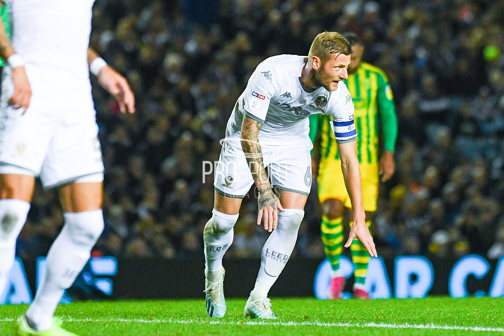 Leeds United defender Liam Cooper (6) is injured during the EFL Sky Bet Championship match between Leeds United and West Bromwich Albion at Elland Road, Leeds, England on 1 October 2019.