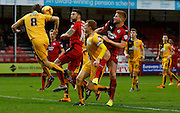 Luke Berry of Cambridge United clears a dangerous ball in to the box with a header during the Sky Bet League 2 match between Crawley Town and Cambridge United at the Checkatrade.com Stadium, Crawley, England on 9 January 2016. Photo by Andy Walter.