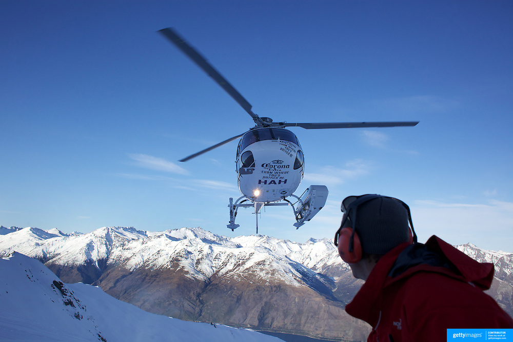 A helicopter transports athletes during the World Heli Challenge Freestyle Day at Mount Albert on Minaret Station, Wanaka, New Zealand. 31st July 2011