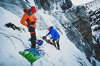 Nathan Smith and Chris Thomas suit up for the first winter ascent of the mixed line, Bone Collector, M5, WI5, III, Little Cottonwood Canyon, Utah.