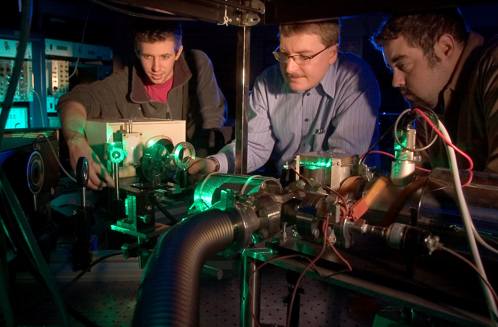 Green Laser Lab in Russ College:  Bradley Smith(gray Feece), Daniel Schaaff(brown shirt), Dr. Wojciech Jadwisienczak