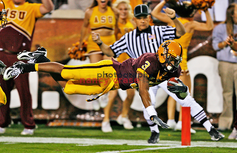 Rudy Burgess, senior, Arizona State University, leaps into the end zone for a touchdown in a game against University of Southern California on November 22, 2007.  USC won 44 to 24.