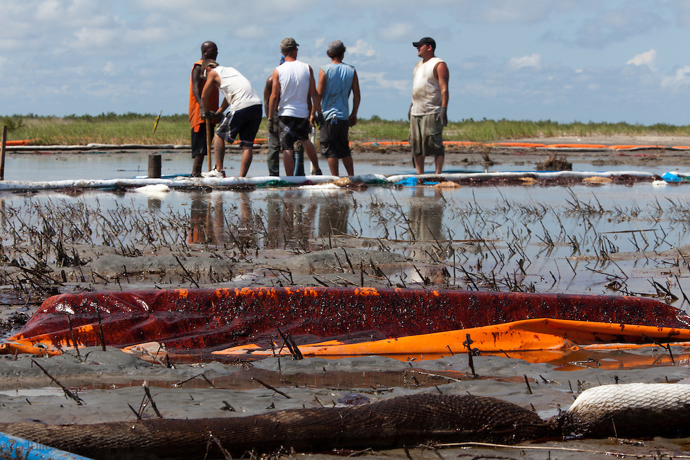 May 22, 2010, Workers hired by BP to clean Build a damn on Port Fourchon's beach, Louisiana to protect the beach from the BP oil spill.