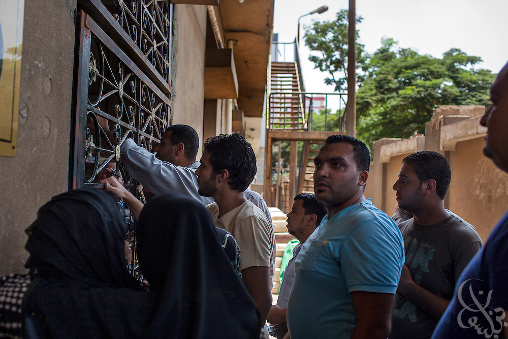 Egyptians plead with guards to allow them inside the Health Insurance Hospital morgue to try to find their missing loved ones August 15, 2013 in the Nasr City district of Cairo, Egypt.  A day after a violent raid by security forces on the supporters of deposed Egyptian President Mohamed Morsi, the country is trying to come to terms with the news that at least 600 people were killed and thousands more injured across Egypt during the raid on Rabaah al-Adawiya, and another, smaller protest camp in the district of Giza across town.