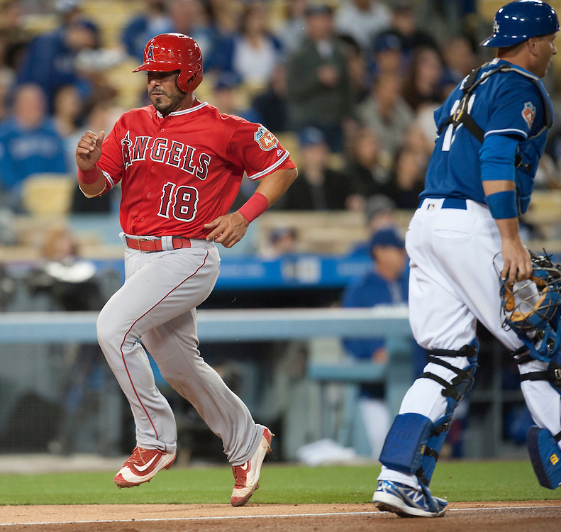 The Angels' Geovany Soto scores past Dodgers' catcher A.J. Ellis in the third inning during their Freeway Series game Friday night at Dodger Stadium.<br /> <br /> <br /> ///ADDITIONAL INFO:   <br /> <br /> freeway.0402.kjs  ---  Photo by KEVIN SULLIVAN / Orange County Register  --  4/1/16<br /> <br /> The Los Angeles Angels take on the Los Angeles Dodgers at Dodger Stadium during the Freeway Series Friday.<br /> <br /> <br />  4/1/16