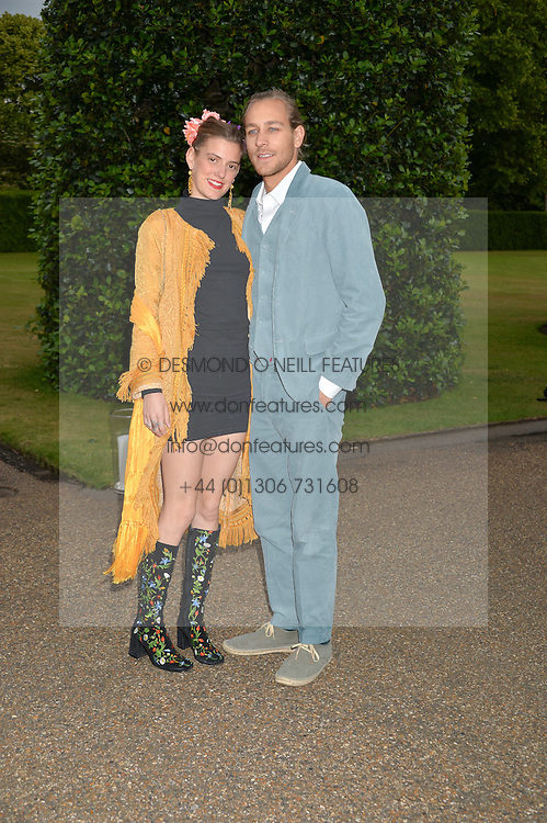 LEA MARCACCINI and TOBY KNOTT at The Ralph Lauren & Vogue Wimbledon Summer Cocktail Party at The Orangery, Kensington Palace, London on 22nd June 2015.  The event is to celebrate ten years of Ralph Lauren as official outfitter to the Championships, Wimbledon.