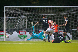 Hamilton's Lewis Longridge scoring their second goal past Falkirk's keeper Michael McGovern.<br /> Hamilton 2 v 0 Falkirk, Scottish Championship played today at New Douglas Park.<br /> &copy;Michael Schofield.