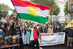 London, UK. 13 October, 2019.  Kurdish supporters of the YPG march in protest against Turkey's invasion of Kurdish-held territory in north-eastern Syria. According to the UN, 130,000 people have left their homes since the launch earlier this week of the assault by Turkey and Syrian rebel fighters. At least 38 civilians and more than 80 Kurdish fighters are reported to have been killed.