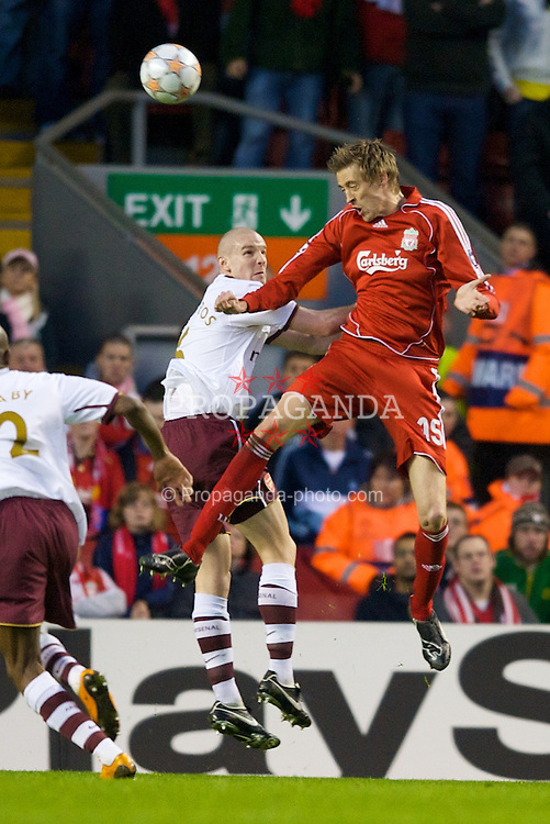 LIVERPOOL, ENGLAND - Tuesday, April 8, 2008: Liverpool's Peter Crouch and Arsenal's Philippe Senderos during the UEFA Champions League Quarter-Final 2nd Leg match at Anfield. (Photo by David Rawcliffe/Propaganda)