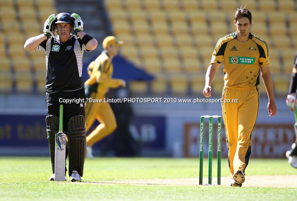NZ batsman Scott Styris adjusts his helmet as bowler Mitchell Johnson walks past.<br /> Fifth Chappell-Hadlee Trophy one-day international cricket match - New Zealand v Australia at Westpac Stadium, Wellington. Saturday, 13 March 2010. Photo: Dave Lintott/PHOTOSPORT