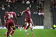 Ipswich Town striker James Norwood (10) heads the ball during the EFL Sky Bet League 1 match between Milton Keynes Dons and Ipswich Town at stadium:mk, Milton Keynes, England on 17 September 2019.