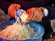 "20 SEPTEMBER 2018 - BANGKOK, THAILAND:  Making ""som tam"" (papaya salad). Street food venders of Sukhumvit Soi 16 in Bangkok.    PHOTO BY JACK KURTZ"