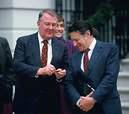 Ed Meese gives Casper Weinberger a small knife.  Weinberger was known at &quot;Cap the knife&quot; for his massive cuts at the Department of Defense.  <br /> <br /> Photo by Dennis Brack