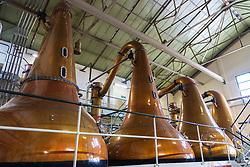 Stills inside still room Room at Lagavulin Distillery on island of Islay in Inner Hebrides of Scotland, UK