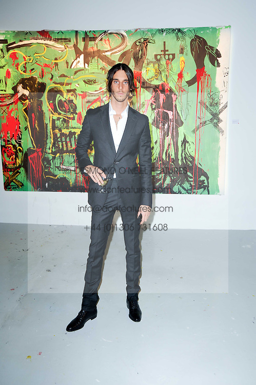 Vladimir Restoin Roitfeld at a private view of Nicolas Pol's paintings entitled 'Mother of Pouacrus' held at The Dairy, Wakefield Street, London WC1 on 14th October 2010.