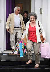 © Licensed to London News Pictures. 01/06/2016. London, UK. COLIN and ALISON HUMPHREYS, the father-in-law and mother-in-law of Ronnie Wood, leave the Rolling Stones guitarist's London home holding gifts, two days after Ronnie Wood and his wife Sally Humphreys had twins. Ronnie Wood also turned 69 today (weds).  Photo credit: Ben Cawthra/LNP