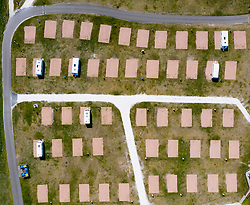 Aerial view of empty caravan pitches at Elie Holiday Park near Elie in Fife. The park would normally be busy at this time year but is closed due to the Covid-19 pandemic.