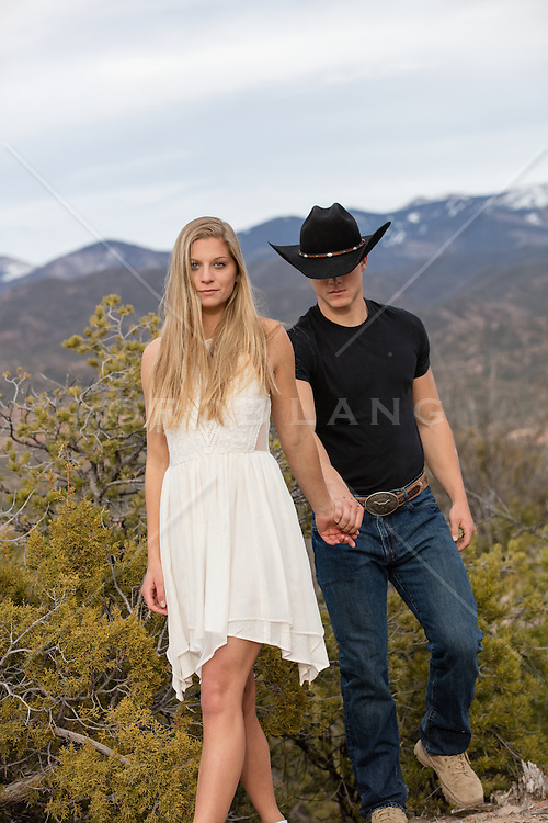 beautiful girl with a cowboy in the wilderness of New Mexico